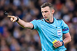 Referee Michael Oliver gestures during the UEFA Champions League 2017-18 quarter-finals (2nd leg) match between Real Madrid and Juventus at Estadio Santiago Bernabeu on 11 April 2018 in Madrid, Spain. Photo by Diego Souto / Power Sport Images
