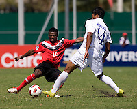 Tony Cerrato (14) of Honduras tries to take the ball away from Shadrack Mmunga (14) of Canada during the group stage of the CONCACAF Men's Under 17 Championship at Catherine Hall Stadium in Montego Bay, Jamaica. Canada tied Honduras, 0-0.