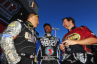 Oct. 30, 2011; Las Vegas, NV, USA: NHRA top fuel dragster drivers Tony Schumacher (left), Antron Brown (center) and Del Worsham talk before the Big O Tires Nationals at The Strip at Las Vegas Motor Speedway. Mandatory Credit: Mark J. Rebilas-