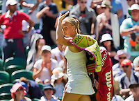 England, London, June 30, 2015, Tennis, Wimbledon, Kiki Bertens (NED) waves to the public after losing to Kvitova<br /> Photo: Tennisimages/Henk Koster