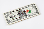 Money Trap.  Dollar bill made into mouse trap.