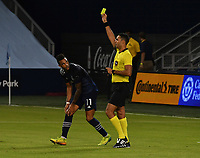 KANSAS CITY, KS - OCTOBER 07: #11 Khiry Shelton of Sporting Kansas City sees a yellow card from referee Marcos de Oliveira during a game between Chicago Fire and Sporting Kansas City at Children's Mercy Park on October 07, 2020 in Kansas City, Kansas.