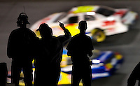 Fans watch cars go around the track during the Bank of America 500 NASCAR race at Lowes's Motor Speedway in Concord, NC.