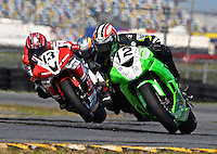 Ricky Orlando (12) leads a pack of motorcycles during the Daytona 200 motorcycle race at Daytona International Speedway, Daytona Beach, FL, March 2011.(Photo by Brian Cleary/www.bcpix.com)