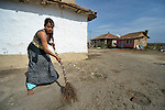 """THIS PHOTO IS AVAILABLE AS A PRINT OR FOR PERSONAL USE. CLICK ON """"ADD TO CART"""" TO SEE PRICING OPTIONS.   Pepa Adre, 25, sweeps the ground around her home in a largely Roma, Turkish-speaking neighborhood of Dobrich, in the northeast of Bulgaria."""