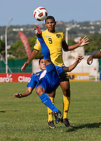 Omar Holness (9) of Jamaica defends the bicycle kick of Bryan Lemus (18) of Guatemala during the group stage of the CONCACAF Men's Under 17 Championship at Catherine Hall Stadium in Montego Bay, Jamaica. Jamaica defeated Guatemala, 1-0.