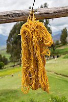 Peru, Urubamba Valley, Quechua Village of Misminay.  Dyed Yarn Drying in the Sun.