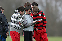 Hoxton Foxes FC players read a photocopy of the local newspaper at Hackney Marshes - 02/03/08 - MANDATORY CREDIT: Gavin Ellis/TGSPHOTO - Self billing applies where appropriate - Tel: 0845 094 6026