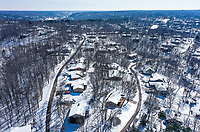 Snow capped houses are shown, Thursday, February 18, 2021 at Tanyard Creek in Bella Vista. Check out nwaonline.com/210219Daily/ for today's photo gallery. <br /> (NWA Democrat-Gazette/Charlie Kaijo)