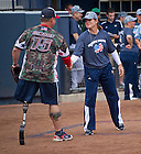 """Sept. 29. 2013; Notre Dame Softball head coach Deanna Gumpf shakes hands with William """"Spanky"""" Gibson after the game.<br /> <br /> Photo by Matt Cashore/University of Notre Dame"""