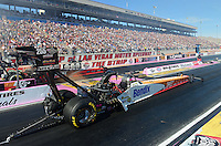 Oct. 27, 2012; Las Vegas, NV, USA: NHRA top fuel driver Clay Millican during qualifying for the Big O Tires Nationals at The Strip in Las Vegas. Mandatory Credit: Mark J. Rebilas-