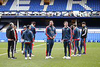 Swansea City players pictured on the pitch ahead of the Barclays Premier League match between Everton and Swansea City played at Goodison Park, Liverpool