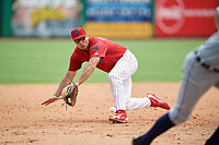 Clearwater Threshers third baseman Damek Tomscha (21) makes a diving stop before throwing the runner out at home on a force play with the bases loaded during the first game of a doubleheader against the Lakeland Flying Tigers on June 14, 2017 at Spectrum Field in Clearwater, Florida.  Lakeland defeated Clearwater 5-1.  (Mike Janes/Four Seam Images)