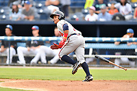 Rome Braves left fielder Randy Ventura (11) runs to first base during a game against the Asheville Tourists at McCormick Field on July 27, 2017 in Asheville, North Carolina. The Braves defeated the Tourists 6-3. (Tony Farlow/Four Seam Images)