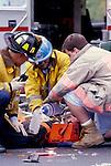 EMTs attending to badly injured victim