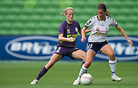 MELBOURNE, AUSTRALIA - DECEMBER 18: Elisa D'OVIDIO of the Glory and Ashley Brown of the Victory compete for the ball during the round 7 W-League match between the Melbourne Victory and the Perth Glory at AAMI Park on December 18, 2010 in Melbourne, Australia. (Photo Sydney Low / asteriskimages.com)