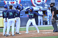 Asheville Tourists second baseman Luis Santana (3) is greeted by teammates after hitting a home run during a game against the Brooklyn Cyclones on May 6, 2021 at McCormick Field in Asheville, NC. (Tony Farlow/Four Seam Images)