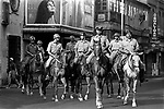 Mounted police battalion on a patrol on a street in Kolkata, India.