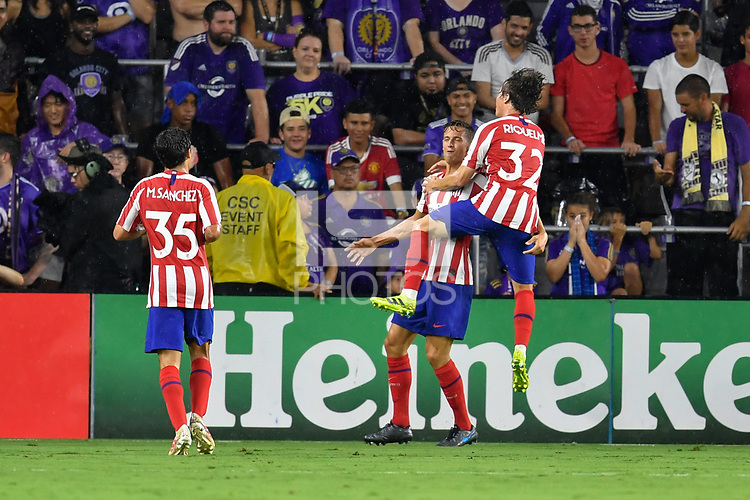 Orlando, FL - Wednesday July 31, 2019:  Marcos Llorente #14, Goal Celebration, Rodrigo Riquelme #32, Manu Sánchez #35 during the Major League Soccer (MLS) All-Star match between the MLS All-Stars and Atletico Madrid at Exploria Stadium.