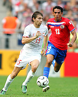 Ebi Smolarek (15) of Poland races away from Leonardo Gonzalez (12) of Costa Rica. Poland defeated Costa Rica 2-1 in their FIFA World Cup Group A match at FIFA World Cup Stadium, Hanover, Germany, June 20, 2006.