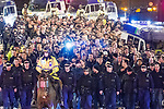 """© Joel Goodman - 07973 332324 . 23/02/2012 . Manchester , UK . A large number of police contain about 150 travelling Ajax fans and lead them on foot through Manchester and Salford to Old Trafford , closing roads to traffic as they go . The fans chant """"Amsterdam hooligans"""" as they go . This ahead of Manchester United hosting Ajax Europa at Old Trafford in the UEFA cup . Photo credit : Joel Goodman"""
