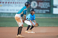 Dry Pond Blue Sox second baseman Carson Phunteck (8) (Langtree Charter HS) tries to keep Nick Solomita (7) (UNC Greensboro) of the Mooresville Spinners close to the base at Moor Park on July 2, 2020 in Mooresville, NC.  The Spinners defeated the Blue Sox 9-4. (Brian Westerholt/Four Seam Images)