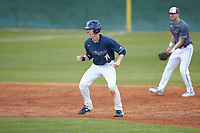 Mitch Farris (15) of the Wingate Bulldogs takes his lead off of second base against the Concord Mountain Lions at Ron Christopher Stadium on February 1, 2020 in Wingate, North Carolina. The Bulldogs defeated the Mountain Lions 8-0 in game one of a doubleheader. (Brian Westerholt/Four Seam Images)