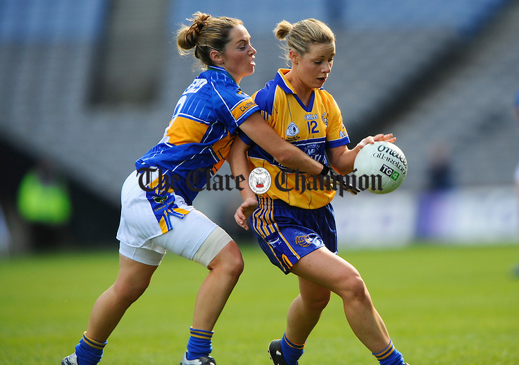 Clare's Una Downes is tackled by Tippearry's Aoife O Dwyer during the Intermediate Ladies Football final at Croke Park. Photograph by John Kelly.