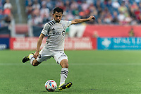 FOXBOROUGH, MA - JULY 25: Mathieu Choiniere #29 of CF Montreal passes the ball during a game between CF Montreal and New England Revolution at Gillette Stadium on July 25, 2021 in Foxborough, Massachusetts.