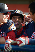 Peoria Chiefs catcher Luis Cruz (30) photo bomb in the dugout before a game against the Lansing Lugnuts on June 6, 2015 at Cooley Law School Stadium in Lansing, Michigan.  Lansing defeated Peoria 6-2.  (Mike Janes/Four Seam Images)