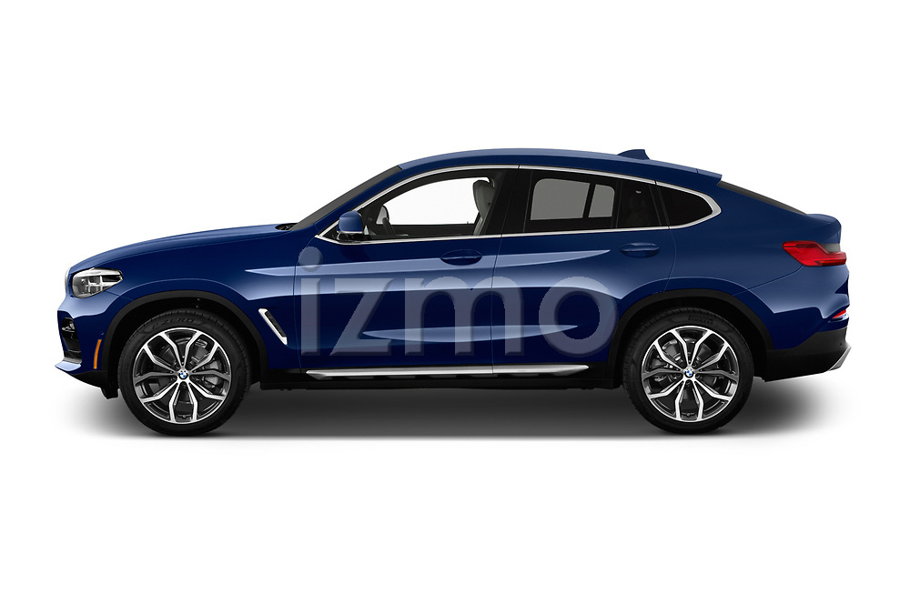 Car driver side profile view of a 2020 BMW X4 xDrive30i 5 Door SUV