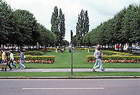 Welwyn: Garden City, Hertfordshire--the first impression: looking west from Railway St. entrance along Howardsgate Green. Shops either side. Photo '87.