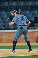 Connor McVey (18) of the Cincinnati Bearcats at bat against the Wake Forest Demon Deacons at Wake Forest Baseball Park on February 21, 2014 in Winston-Salem, North Carolina.  The Bearcats defeated the Demon Deacons 5-0.  (Brian Westerholt/Four Seam Images)
