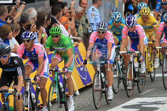 The peloton including Green Jersey leader Alessandro Petacchi (ITA) Lampre-Farnese Vini and Yellow Jersey leader Alberto Contado (ESP) Astana on the Champs-Elysees during the final Stage 20 of the 2010 Tour de France running 102.5km from Longjumeau to Paris Champs-Elysees, France. 25th July 2010.<br /> (Photo by Eoin Clarke/NEWSFILE).<br /> All photos usage must carry mandatory copyright credit (© NEWSFILE | Eoin Clarke)