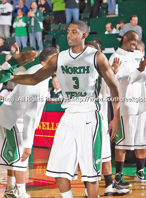 North Texas Mean Green guard Alzee Williams (3) in action during the game between the Louisiana Lafayette Ragin Cajuns and the University of North Texas Mean Green at the North Texas Coliseum,the Super Pit, in Denton, Texas. Louisiana Lafayette defeats UNT 57 to 53.