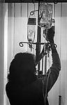Scan of vintage print. File #81-236C #32. Nurse adjusting fluid intravenous . Geisinger Medical Center, Danville, PA. 1981;