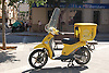 Yellow post office scooter<br />