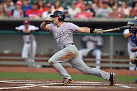 Jacksonville Suns catcher J.T. Realmuto #11 swings at a pitch during a game against the Tennessee Smokies at Smokies Park July 10, 2014 in Kodak, Tennessee. The Suns defeated the Smokies 6-5. (Tony Farlow/Four Seam Images)