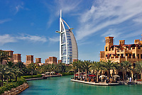 Burj al Arab Hotel, an icon of Dubai built in the shape of the sail of a dhow, stands on an artificial island just off Jumeirah Beach. View across Madinat Jumeirah.  Dubai. United Arab Emirates.