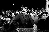Pix:Michael Steele/SWpix...Halifax v Bradford Northern. Rugby League. From the book 'When Push Comes to Shove'....COPYRIGHT PICTURE>>SIMON WILKINSON..Halifax fan (flat caps) v Bradford Northern, Thrum Hall..