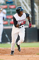 Kannapolis Intimidators shortstop Tim Anderson (2) hustles down the first base line against the Greensboro Grasshoppers at CMC-Northeast Stadium on July 12, 2013 in Kannapolis, North Carolina.  The Grasshoppers defeated the Intimidators 2-1.   (Brian Westerholt/Four Seam Images)