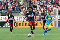 FOXBOROUGH, MA - AUGUST 8: Tajon Buchanan #17 of New England Revolution brings the ball forward during a game between Philadelphia Union and New England Revolution at Gillette Stadium on August 8, 2021 in Foxborough, Massachusetts.