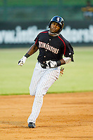 Courtney Hawkins (12) of the Kannapolis Intimidators rounds the bases after hitting a home run against the West Virginia Power at CMC-Northeast Stadium on August 17, 2012 in Kannapolis, North Carolina.  (Brian Westerholt/Four Seam Images)