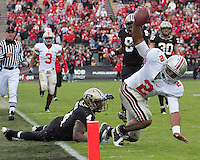 Ohio State quarterback Terrelle Pryor gets stopped just short of the goal line by Dwight McLean (4). The Purdue Boilermakers defeated the Ohio State Buckeyes 26-18 at Ross-Ade Stadium, West Lafayette, Indiana on October 17, 2009..