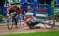 31 AUG 2015 - IPSWICH, GBR - Mark Boaler (left) of Horspath races on as Chris Timms (right) of Birmingham falls during a heat at the men's British Cycle Speedway Championships at Whitton Sports and Community Centre in Ipswich, Suffolk, Great Britain (PHOTO COPYRIGHT © 2015 NIGEL FARROW, ALL RIGHTS RESERVED)