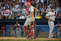 Auburn Doubledays catcher Nic Perkins (43) walks away as manager Jerad Head (right) argues a call on a play at the plate with umpire Drew Saluga (behind Perkins) during a game against the Batavia Muckdogs on July 4, 2017 at Dwyer Stadium in Batavia, New York.  Batavia defeated Auburn 3-2.  (Mike Janes/Four Seam Images)