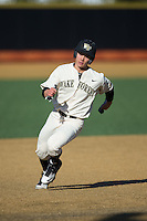 Stuart Fairchild (4) of the Wake Forest Demon Deacons hustles towards third base against the Richmond Spiders at David F. Couch Ballpark on March 6, 2016 in Winston-Salem, North Carolina.  The Demon Deacons defeated the Spiders 17-4.  (Brian Westerholt/Four Seam Images)