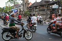 Jimbaran, Bali, Indonesia.  Motorbikes Dominate Balinese Street Traffic.
