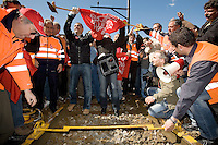 Switzerland. Canton Ticino. Bellinzona. Luciano Carosi and his new wife (couple in center) lift the bar which use to block the rail and the access to the Officine. Railway workers have decided to stop the strike and the building's occupation. Officine FFS. Stabilimento Industriale SBB CFF FFS Cargo. 7.04.08 © 2008 Didier Ruef