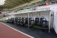 Pictured: Low Cost Vans sponsored seats in the dugout. Saturday 23 August 2014<br /> Re: Premier League, Swansea City FC v Burnley at the Liberty Stadium, south Wales